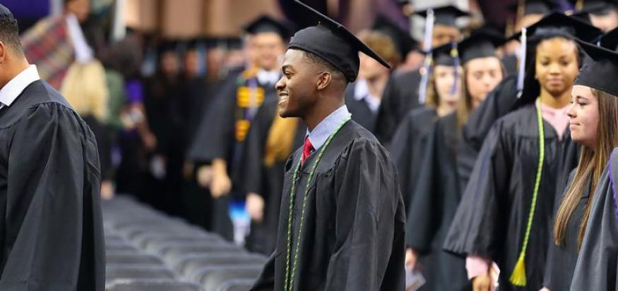 Student walking in Commencement Ceremony